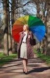 Schöne Frau mit Regenschirm Lizenzfreie Stockfotografie