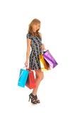 Schöne Frau mit vielen Einkaufstaschen. auf Weiß Stockfoto