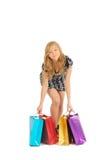 Schöne Frau mit vielen Einkaufstaschen. auf Weiß Lizenzfreies Stockfoto