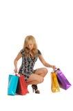 Schöne Frau mit vielen Einkaufstaschen. auf Weiß Stockbilder