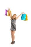 Schöne Frau mit vielen Einkaufstaschen. getrennt auf Weiß Stockfoto