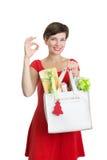 Schöne Frau mit Weihnachtsgeschenken Lizenzfreie Stockfotos