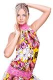 Schöne Frauen in einem farbigen Kleid Stockfoto