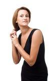 Schöne Frauenholding ihr Haar Lizenzfreie Stockfotografie