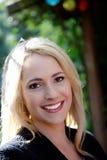 Schöne freundliche junge Frau Stockfoto