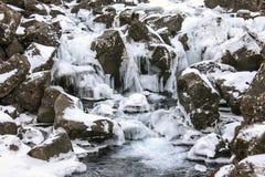 Schöne gefrorene Wasserfälle in Island Lizenzfreie Stockfotos