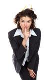 Schöne Geschäftsfrau, die gestikuliert, um Ruhe zu halten Stockbild