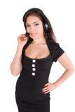 Schöne Geschäftsfrau mit Kopfhörer Stockbild
