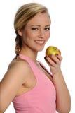 Schöne gesunde Frau mit Apple Lizenzfreies Stockfoto