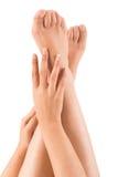 Schöne Hände auf Beinen Stockbild
