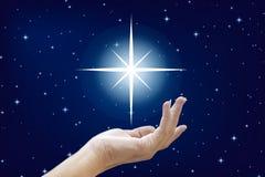 Schöne Hände und die Sterne Stockfotos
