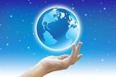 Schöne Hände und Welt Stockbild