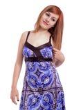 Schöne Jugendliche mit einem blauen Kleid Stockbilder