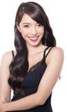 Schöne junge asiatische Frau mit perfekter Haut auf lokalisiertem Hintergrund Stockfotografie