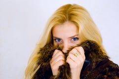 Schöne junge blonde Frau Stockbilder