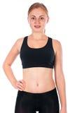 Schöne junge blonde Frau Eine junge athletische Frau in einer Sportklage Stockbilder