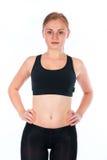 Schöne junge blonde Frau Eine junge athletische Frau in einer Sportklage Stockfotos