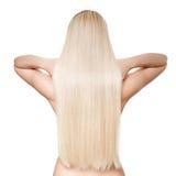 Schöne junge blonde Frau mit dem langen geraden Haar Stockfotografie