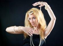 Schöne junge blonde Frau mit dem langen Haar und a Stockfoto