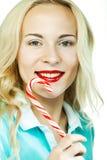 Schöne junge blonde Frau mit Lutscher Lizenzfreie Stockfotos