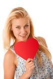 Schöne junge Blondine mit den blauen Augen, die rotes Hirschverbot halten Stockbilder