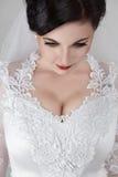 Schöne junge Braut in der Hochzeit Stockbilder