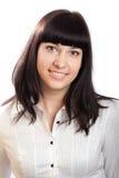 Schöne junge Brunette-Frau auf Weiß. stockbilder