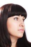 Schöne junge Brunette-Frau auf Weiß. lizenzfreie stockfotos