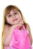 Schöne junge Dame mit einem rosafarbenen Beutel Lizenzfreie Stockfotografie