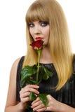 Schöne junge Dame mit Rotrose Lizenzfreies Stockbild