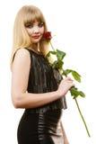 Schöne junge Dame mit Rotrose Stockfotografie
