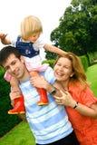 Schöne junge Familie Stockbilder