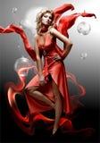 Schöne junge Fantasieluxuxfrau im roten Kleid Stockbild