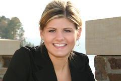 Schöne junge Frau in dem See Stockbilder