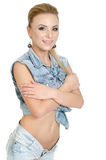 Schöne junge Frau in den Jeans Stockbilder