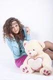 Schöne junge Frau in den Pyjamas Lizenzfreie Stockfotografie