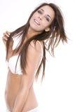 Schöne junge Frau in der weißen reizvollen Wäsche Lizenzfreie Stockfotografie