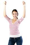 Schöne junge Frau, die Erfolg feiert stockbilder