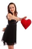 Schöne junge Frau, die rotes Inneres anhält Lizenzfreie Stockbilder