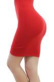 Schöne junge Frau in einem festen roten Kleiderisolat Lizenzfreie Stockfotografie