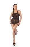 Schöne junge Frau im kurzen Kleid Stockbild