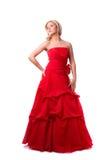 Schöne junge Frau im roten langen Kleid lizenzfreie stockfotos