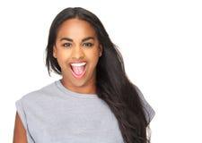 Schöne junge Frau mit überraschtem Ausdruck auf Gesicht Lizenzfreie Stockbilder