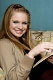 Schöne junge Frau mit Bibel Stockfoto