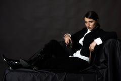 Schöne junge Frau mit cigare Stockfotografie