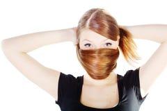 Schöne junge Frau mit dem langen glänzenden Haar lizenzfreie stockfotos