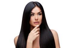 Schöne junge Frau mit dem sauberen gesunden Haar Stockbilder