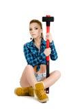 Schöne junge Frau mit einem Hammer Lizenzfreie Stockbilder
