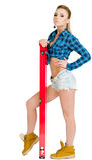 Schöne junge Frau mit einem Hammer Stockfotografie