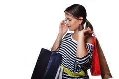 Schöne junge Frau mit Einkaufstaschen Stockfotos